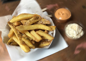 French fries with homemade sauce at Frites Atelier