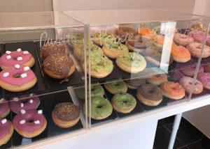 Donuts on display at donut shop Donuttello